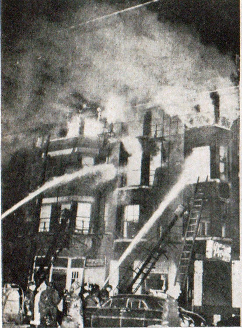 Over 300 fled this group of Chicago tenements but 18 died. S. State Street front showing involvement of tenements at 3616-3618, soon after firemen arrived. Some tenants escaped down two fire escapes shown in picture, but 18 bodies were later found in this front area.
