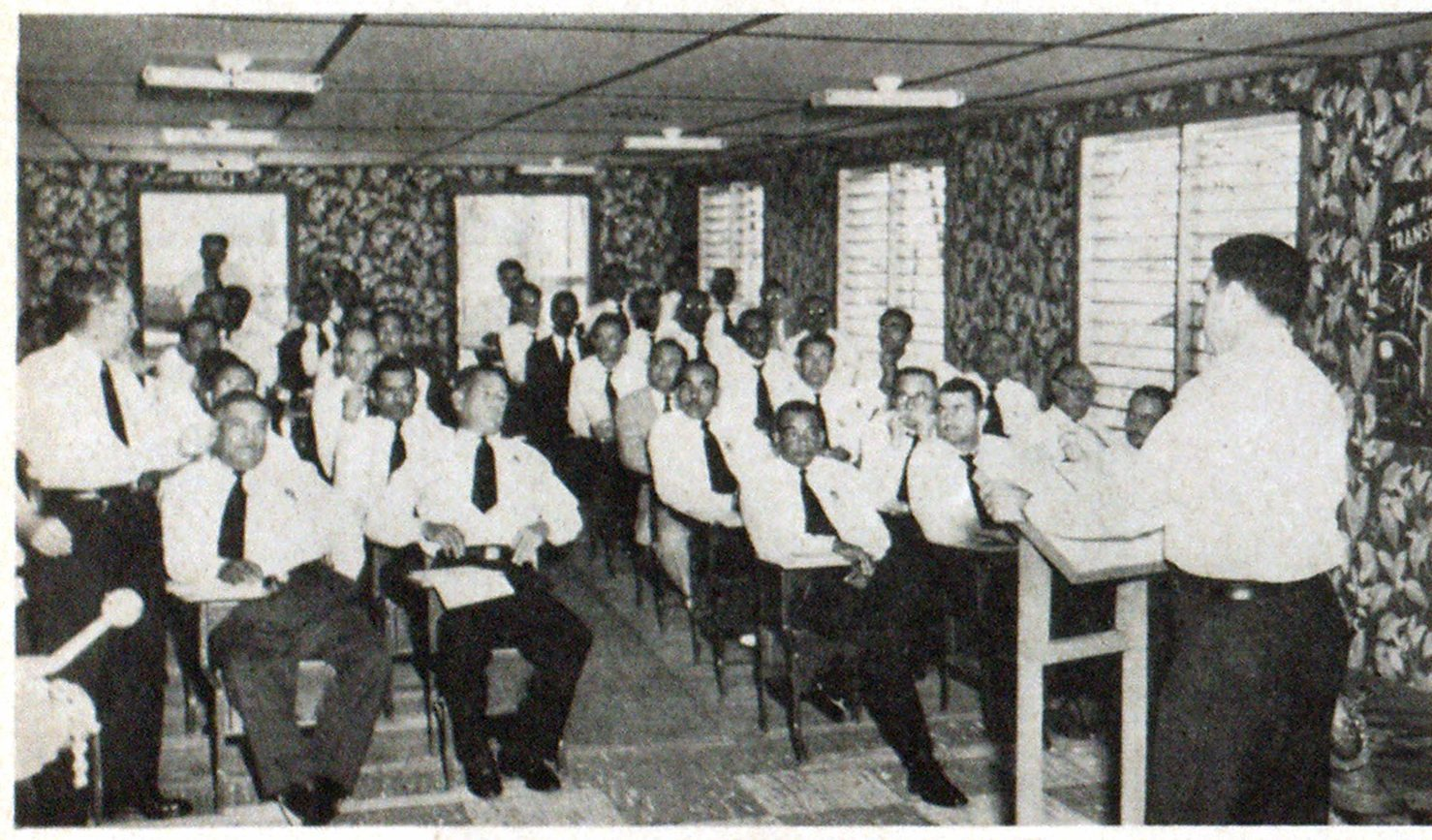 Class rooms at the Fire College are bright and airy, and well equipped. Here Chief Gándara is shown addressing a class of officers.