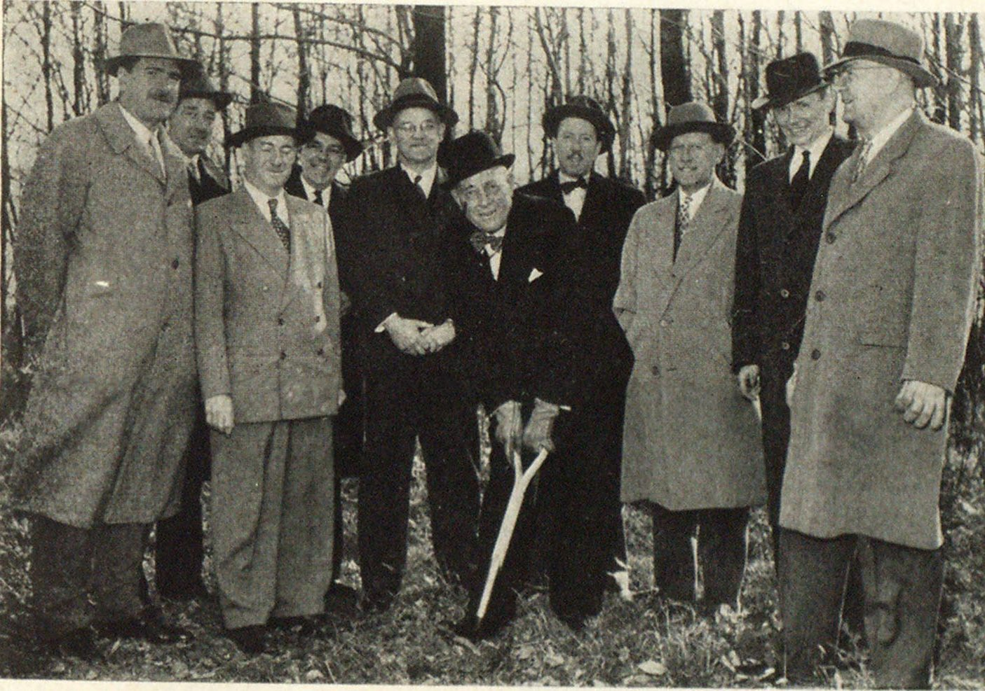 W. E. Baldwin, Honorary President, Underwriters' Laboratories of Canada, turns the first sod for the new Head Office and Testing Station being built by the Laboratories at the Scarborough, Ontario, site. Pictured from left to right are: Alex. S. Hamilton, G. C. Hunter, A. Leslie Ham, J. E. Haskins, Roy B. Whitehead, W. E. Baldwin, R. L. Young, N. G. Bethune, E. F. Tabisz, and L. L. Lewis.