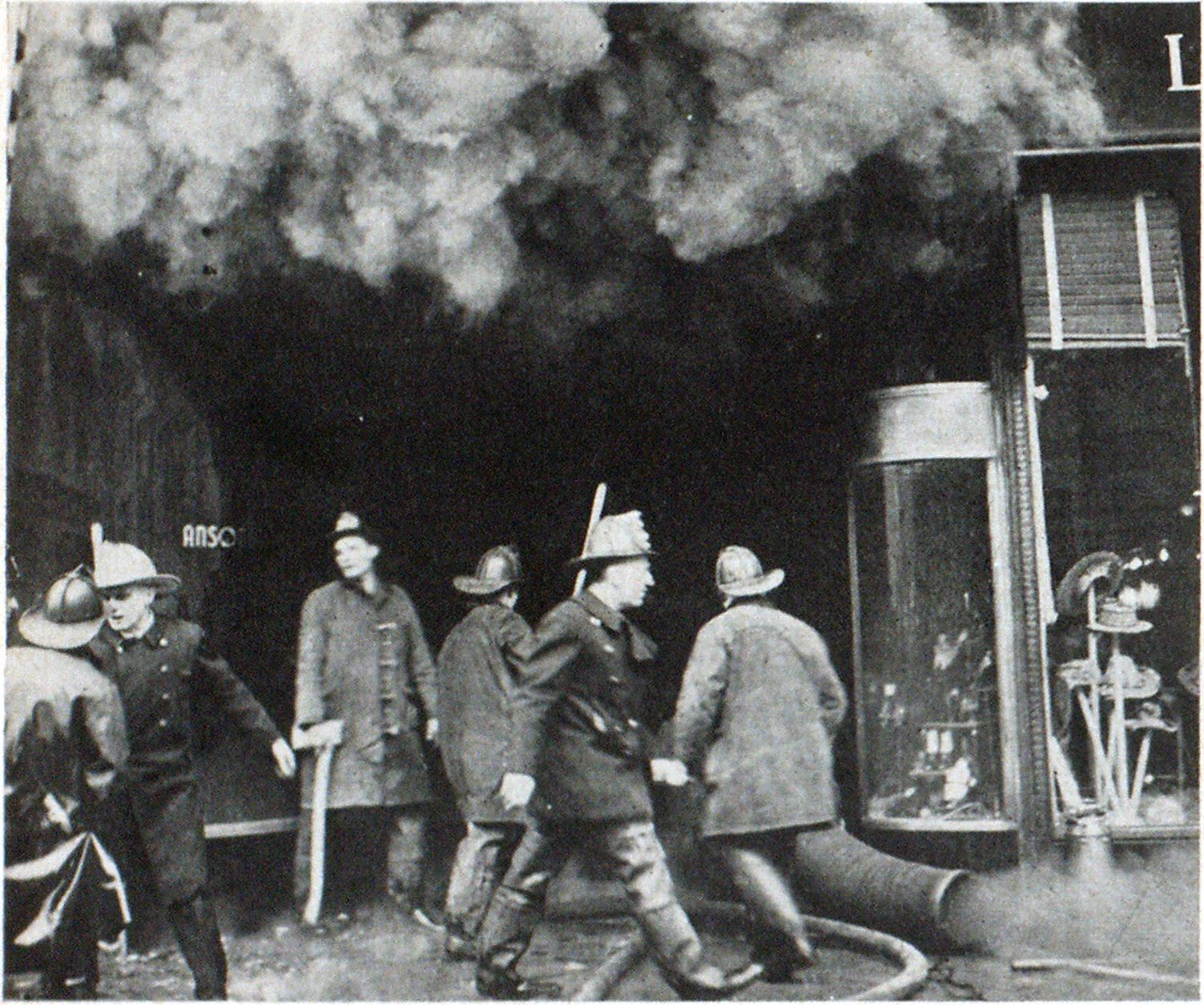 Heavy, hot, toxic smoke from burning cartons and synthetic materials punished Manhattan fire fighters at this 42nd Street shoe store fire until ventilation was accomplished. Note hot smoke rising. Since this fire, the city's fire fighters have been provided with more breathing equipment.