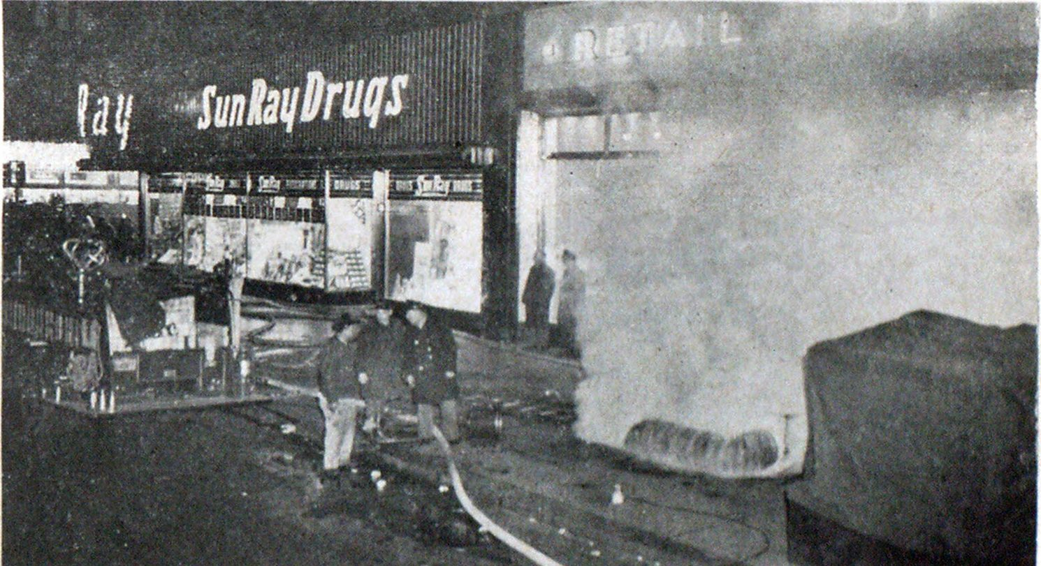 Photo courtesy Philadelphia Fire Department Gasoline-driven portable smoke ejectors and electric circulators were used through this sidewalk and floor openings to rid heavily charged sub-surface areas of the huge Reading Terminal Building of noxious smoke and gases in fire of January 3, 1954.