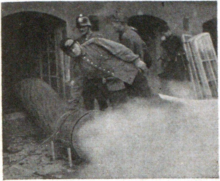 Contrary to general opinion, European fire brigades use both portable and heavy duty mobile smoke removers and blowers. Note the discharge from this electrically driven ejector, of the Helsingfors Fire Department.