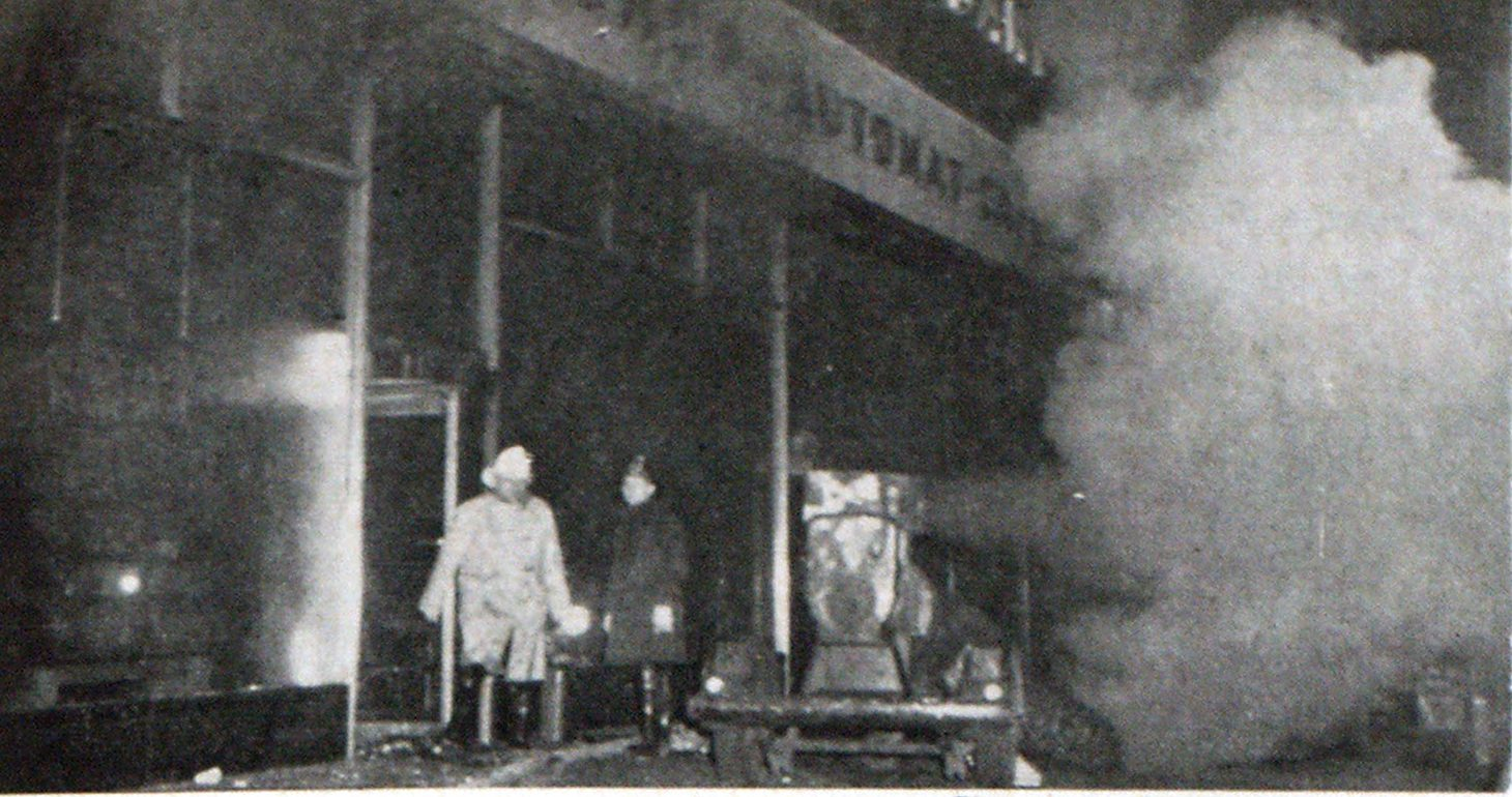The Philadelphia Fire Department used this heavy duty 6100 CFM trailer smoke ejector at the stubborn Sun Ray Drug Store, Reading Terminal fire, January 3, 1954, to pull fumes and smoke through Market street sidewalk opening, permitting men to advance lines in sub-surface areas. Fire Chief George Hink is shown at left.