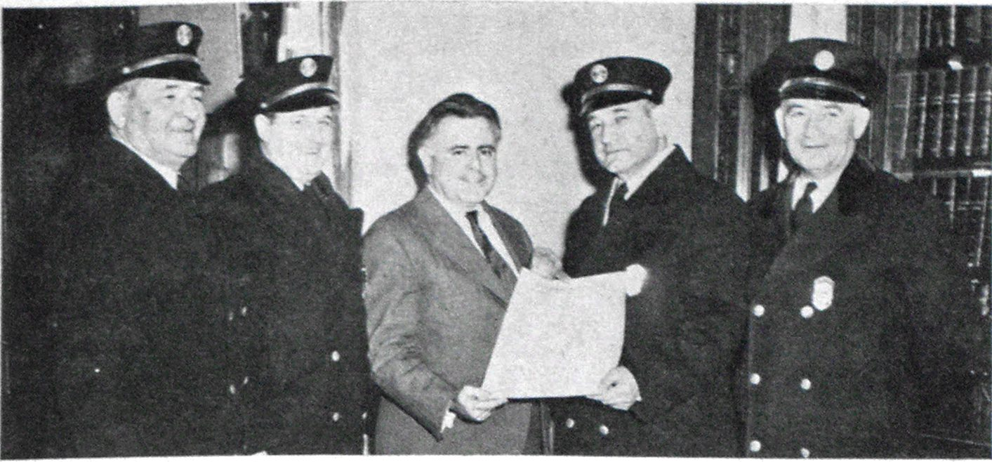 Boston Fire Chiefs' Organization Chartered The Commonwealth of Massachusetts has issued a corporate charter to the Fire Chiefs' Association of Boston, Inc. Formed two years ago, the organization meets monthly in Boston's Hotel Statler. Chief J. Herbert White of Roslindale is president. The above picture was snapped at the informal ceremonies on Beacon Hill and shows president White receiving the charter. Present, left to right, are: Chief Edward J. Galvin of Roxbury; Chief Charles D. Travis of West Roxbury; Secretary of State Edward J. Cronin; Chief White and Chief Patrick E. Collins of Brighton.