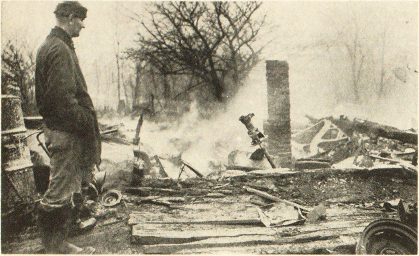 William Raney sadly stares at ruins of his home near New Ashford, Mass., following fire in which his son died in a futile effort to save a sister who had escaped. Raney's wife was badly burned