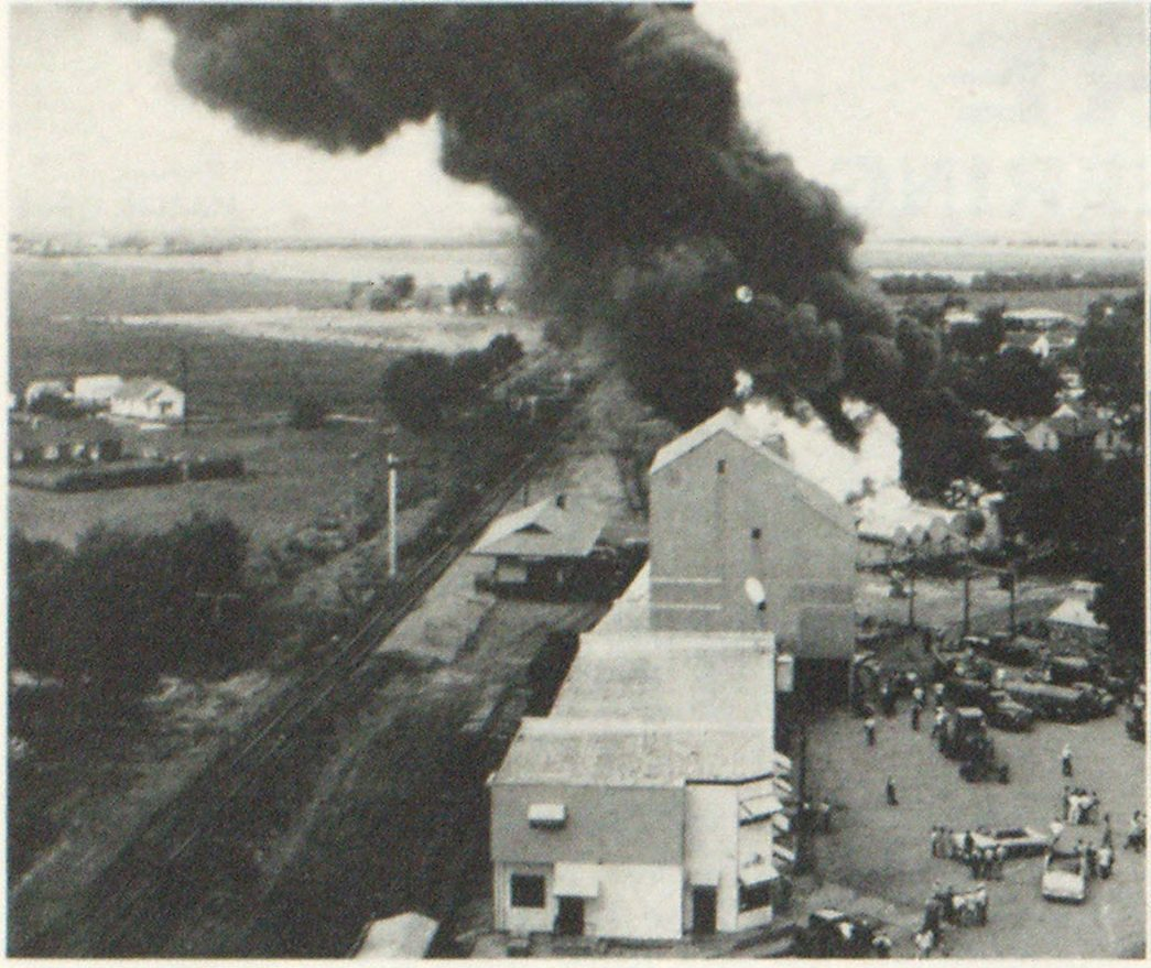 Aerial view of Andale, Kans., petroleum products fire as mutual aid assistance was arriving. Railroad tracks used by crash unit appear in left foreground.