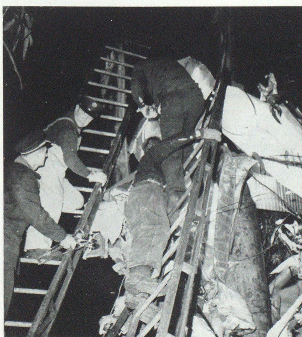 Chief Bruno Bassi (ladder, lower left) directs rescue effort