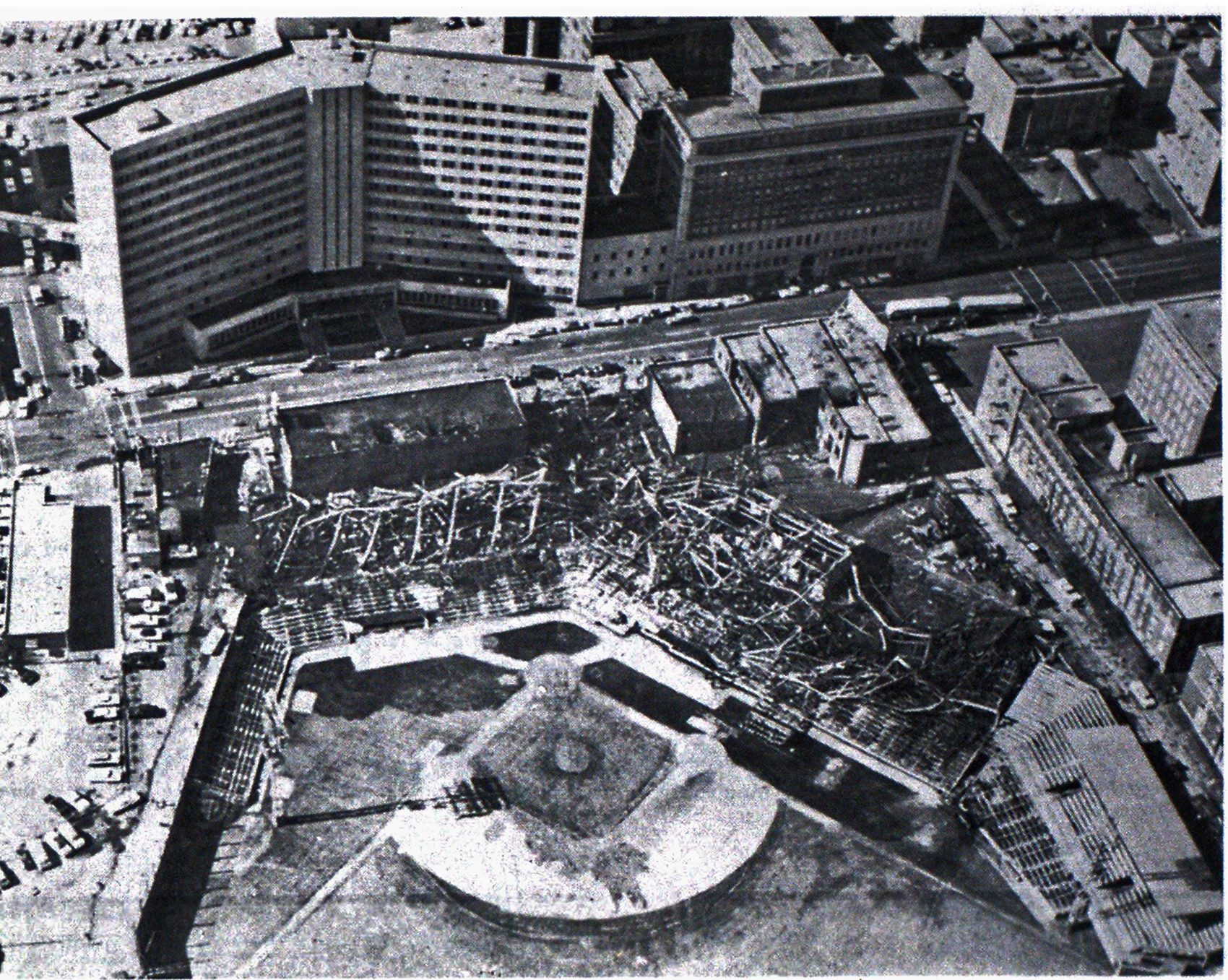Aerial view of destruction on morning following fire. Baptist Hospital is at top of photo. The Maternity Wing of John Gaston Hospital is at right