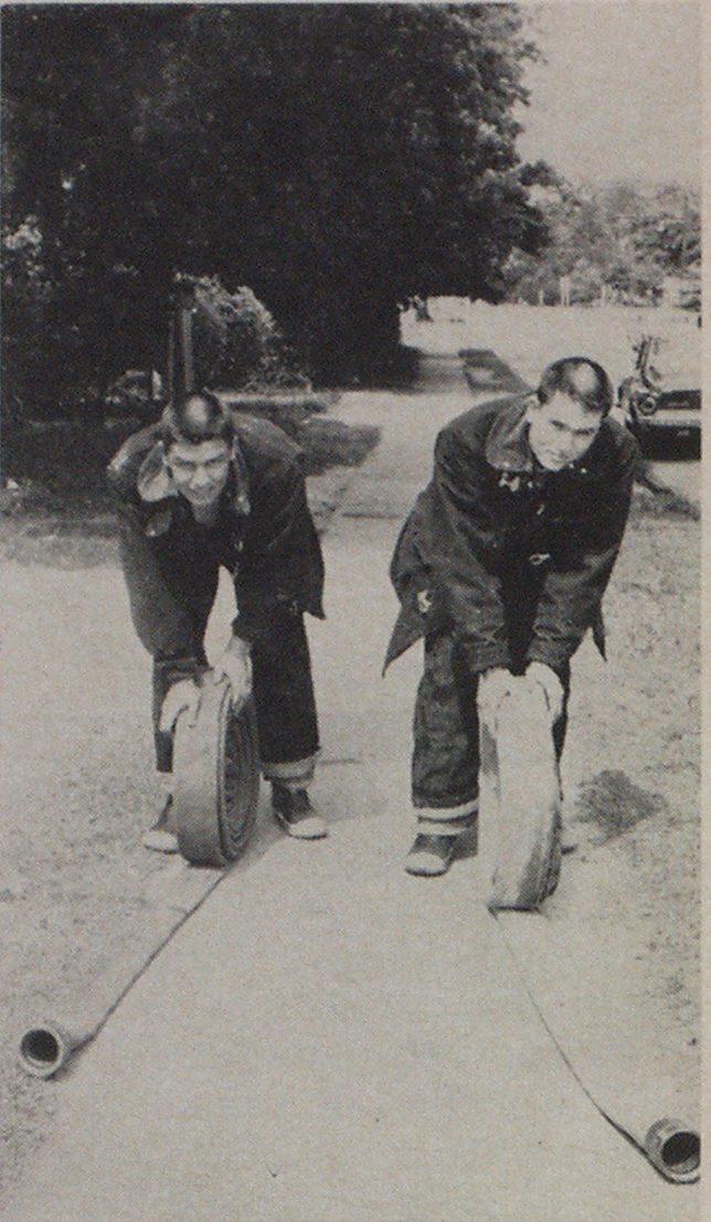 Youngsters pick up 2 1/2-inch hose following a fire