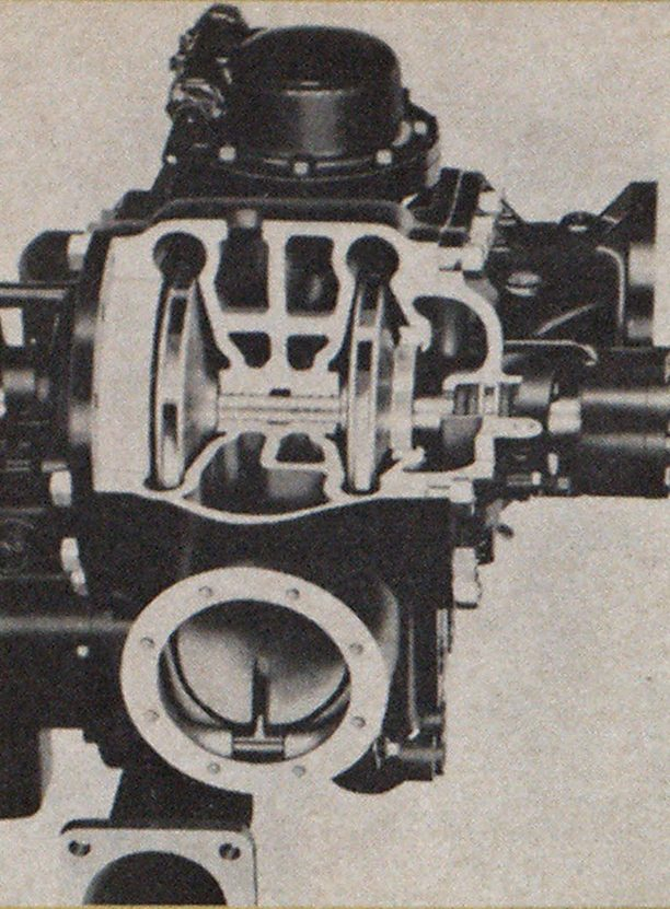Seagrave parallel-series, two-stage centrifugal pump, showing clapper valve in port at lower center.