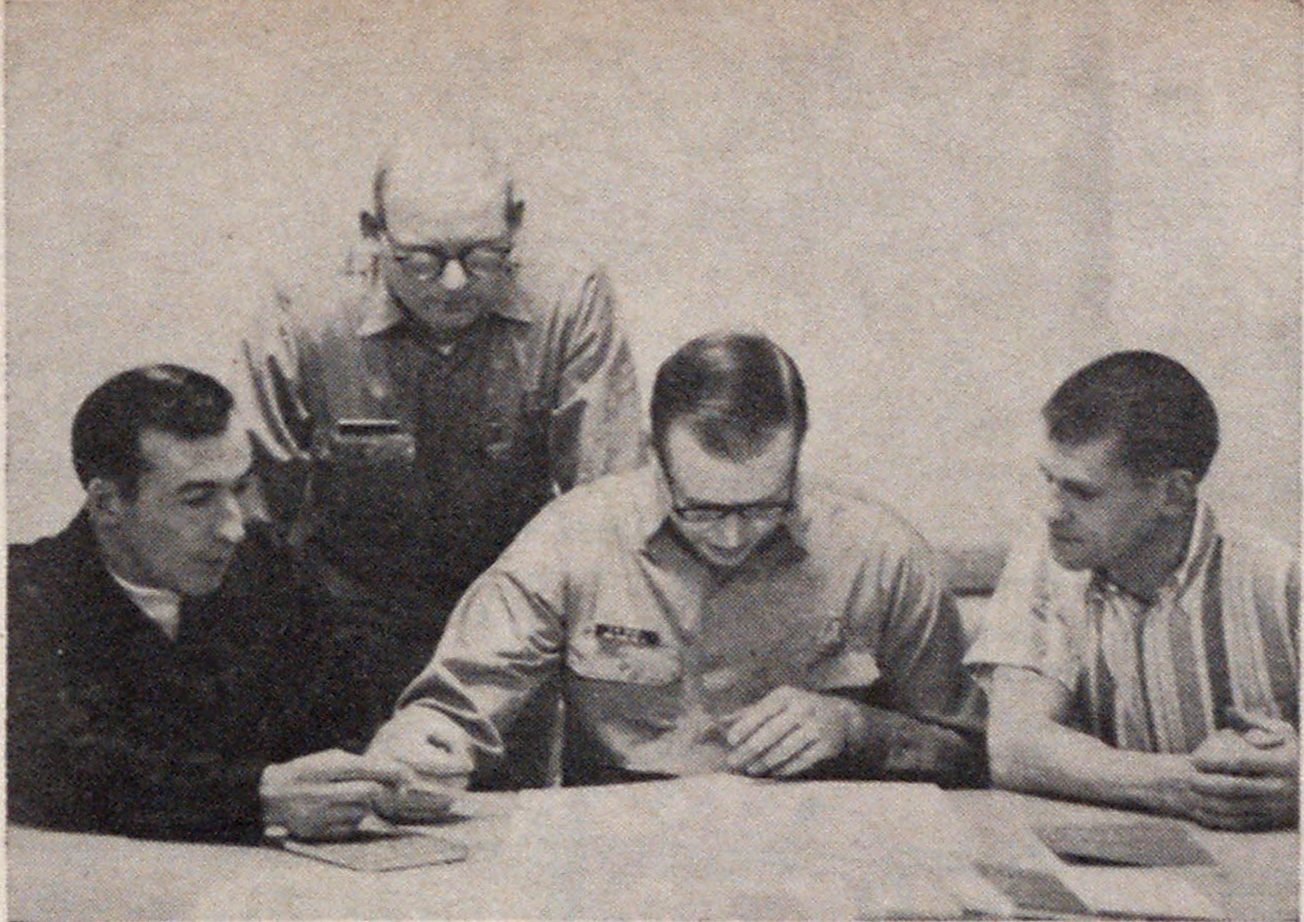 Fire inspectors receive instructions for a factory inspection from Chief Joseph H. Neyhart, standing. Seated are Lyle Keeler, David Weigel and Joseph Hubbard.