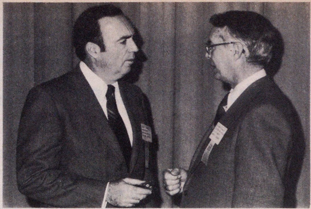 High-rise fires were discussed by Commissioner John T. O'Hagan of New York City, left, shown talking with Director of Fire Robert W. Walker of Memphis.