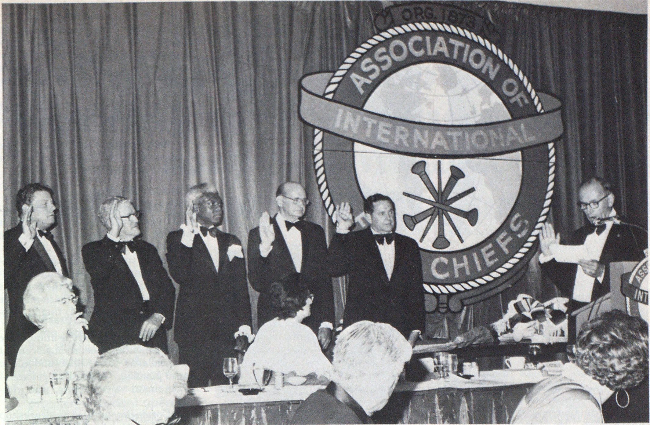 Officers elected at the IAFC 103rd Annual Conference in San Antonio are installed by Past President John F. Hurley, Rochester, N. Y., extreme right. From left are immediate Past President David B. Gratz, Montgomery County, Md.; Treasurer G. A. Mitchell, Opelika. Ala.; 2nd Vice President James H. Shern, Pasadena. Calif.; 1st Vice President John L. Swindle, Birmingham, Ala.; and President Myrle K. Wise, Denver, Colo.