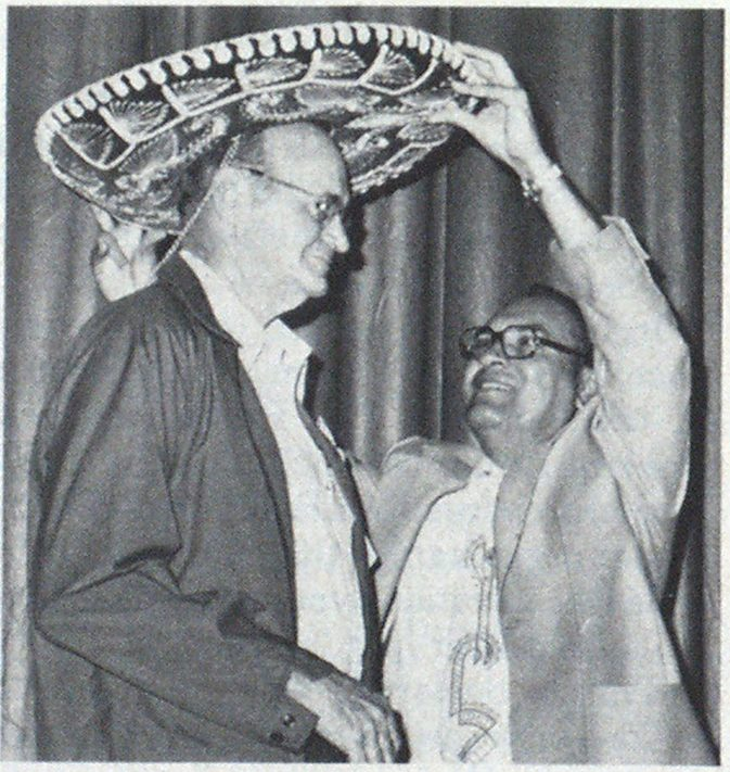 Crowning event for 1st Vice President John L. Swindle is gift of Mexican hat from host Chief I. O Martinez of San Antonio.