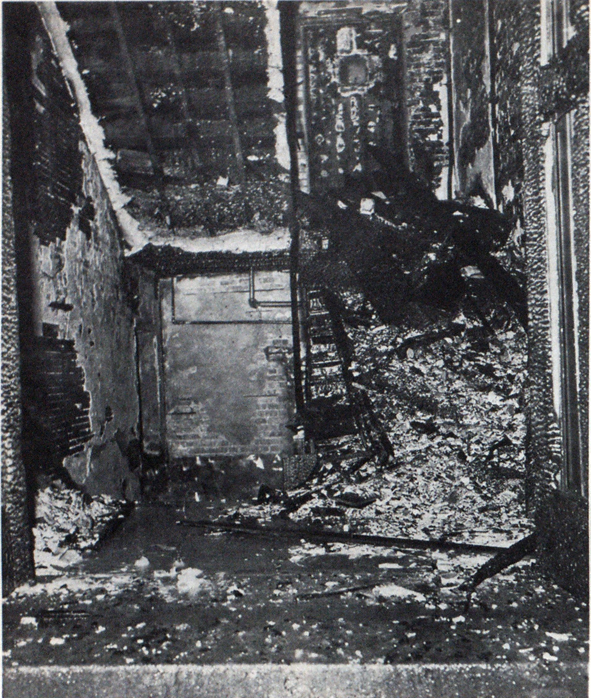 Wooden stairways were factor in rapid spread of fire. Fire, which started in basement, swept up stairs to first-floor door, at left, and continued up stairs at right to second floor, cutting off escape route for children