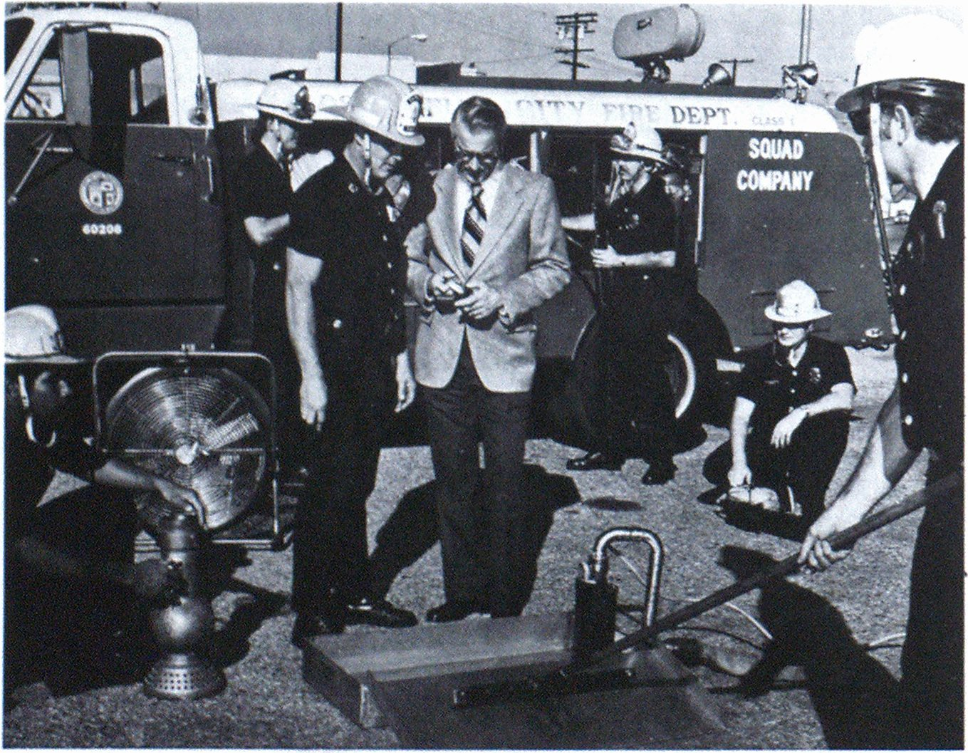 Equipment carried by Squad 4, one of three recently activated squads in the Los Angeles City Fire Department, is viewed by Chief John Gerard, in civilian clothes. The squad supplies manpower and special equipment to companies that lost personnel in retrenchment caused by Proposition 13