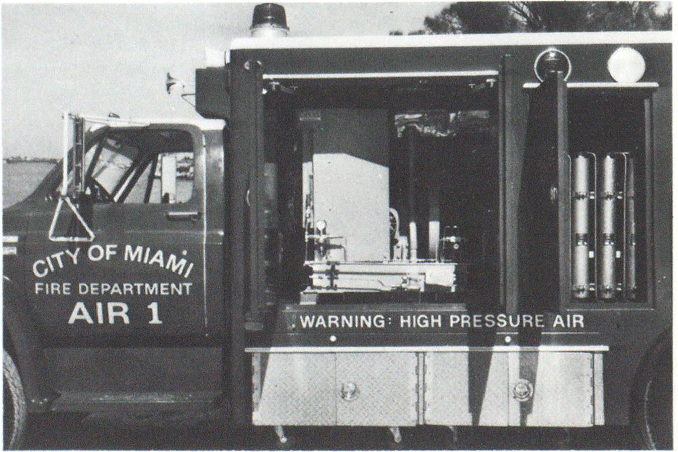 Air compressor rated at 65 cfm at 5000 psi is mounted on Miami Fire Department air supply truck. Purification system, with 27-inch cylinders, is at right.