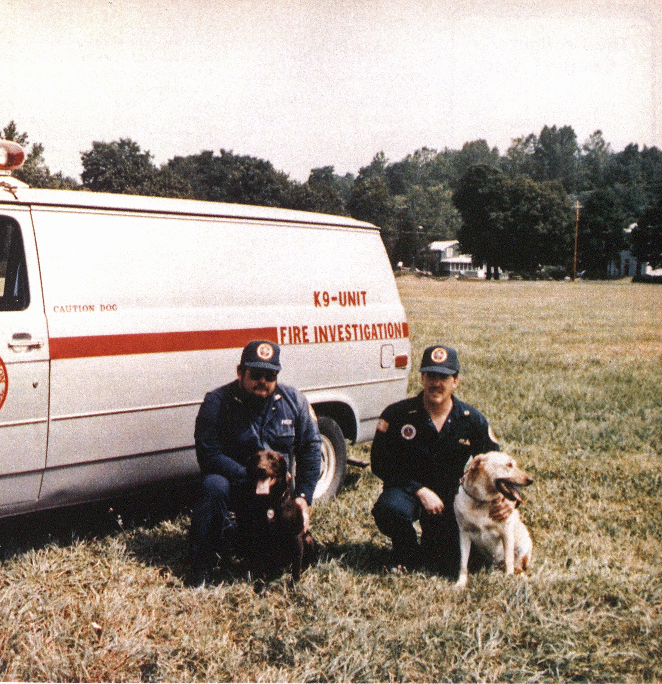 The investigator/canine teams of Richard Rogozinski and Hershey and Michael Knowlton and Buddy.