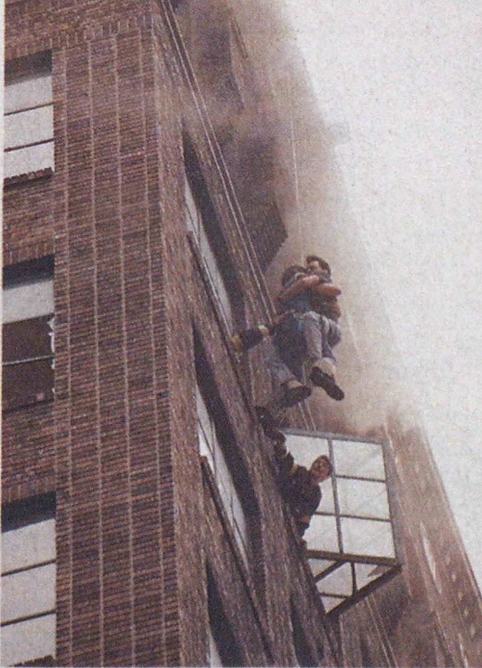Two 12th-floor occupants, unable to escape through interior passages, were driven onto window ledges, where they still were exposed to heavy heat