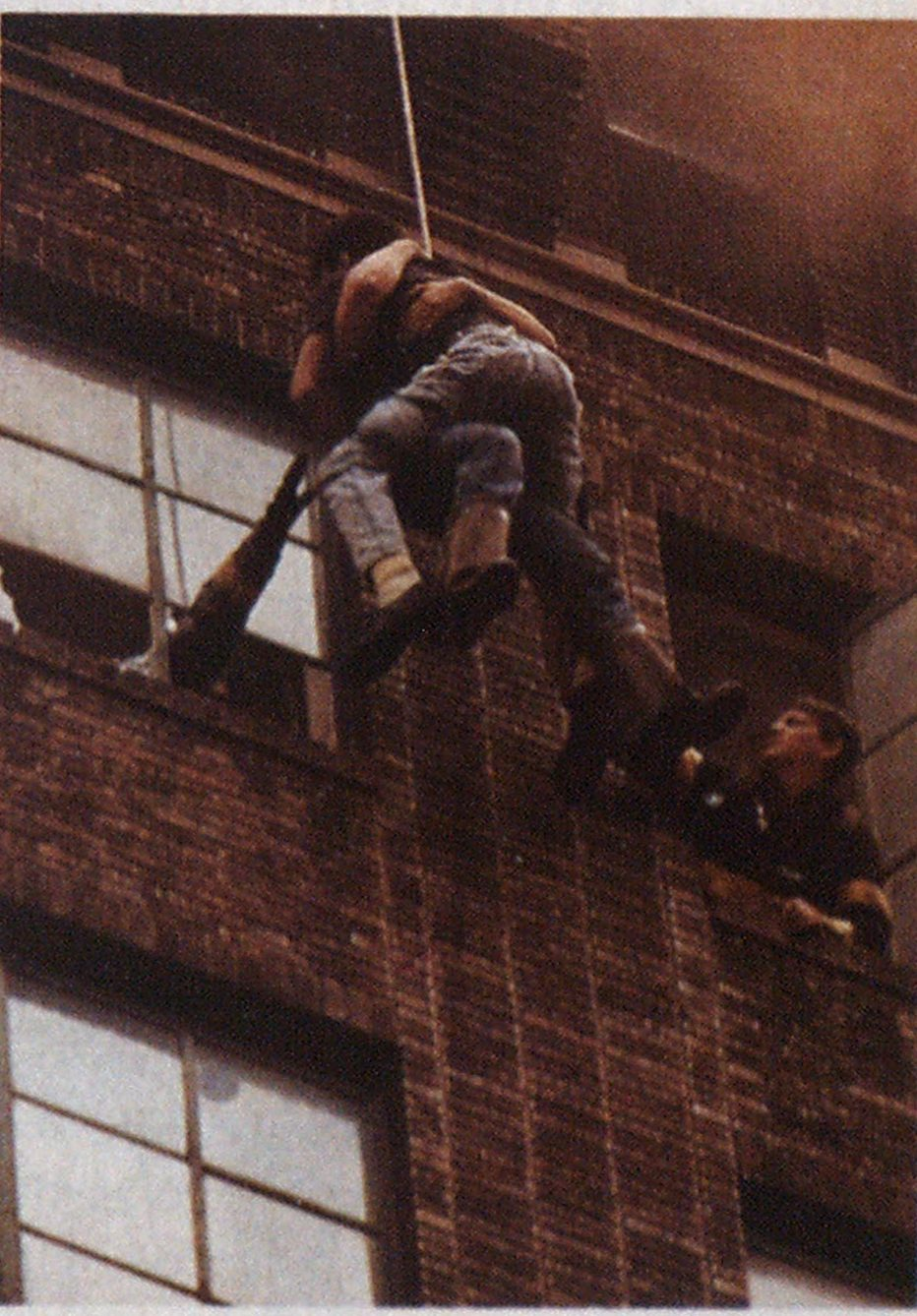 In a panic, the first victim jumped onto Firefighter Barr, placing an extreme impact load on the life-saving rope.