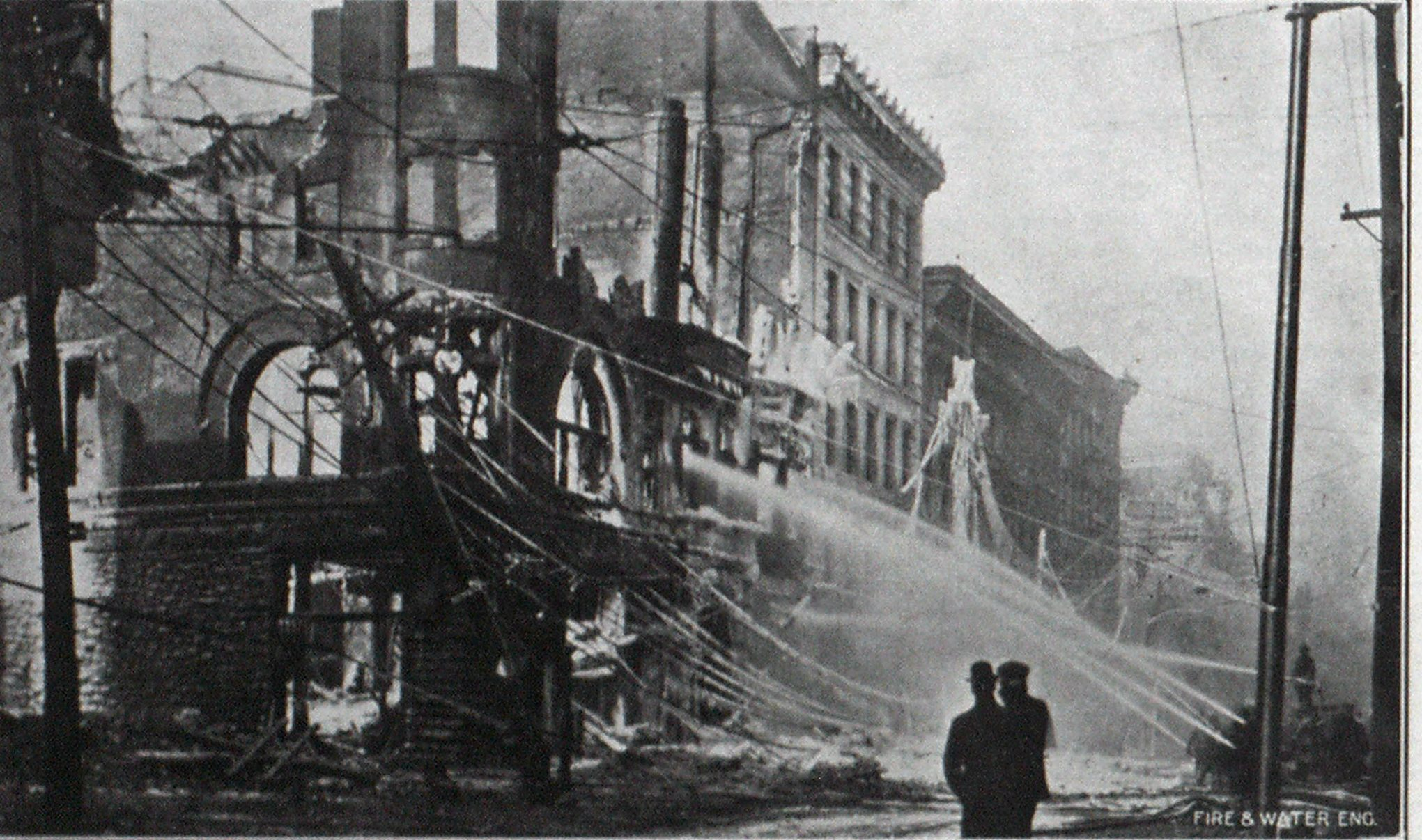 The Y. M. C. A. Building Fire, Utica, Showing Four Deluge Streams and a Turret Nozzle Stream Cooling off Ruins.
