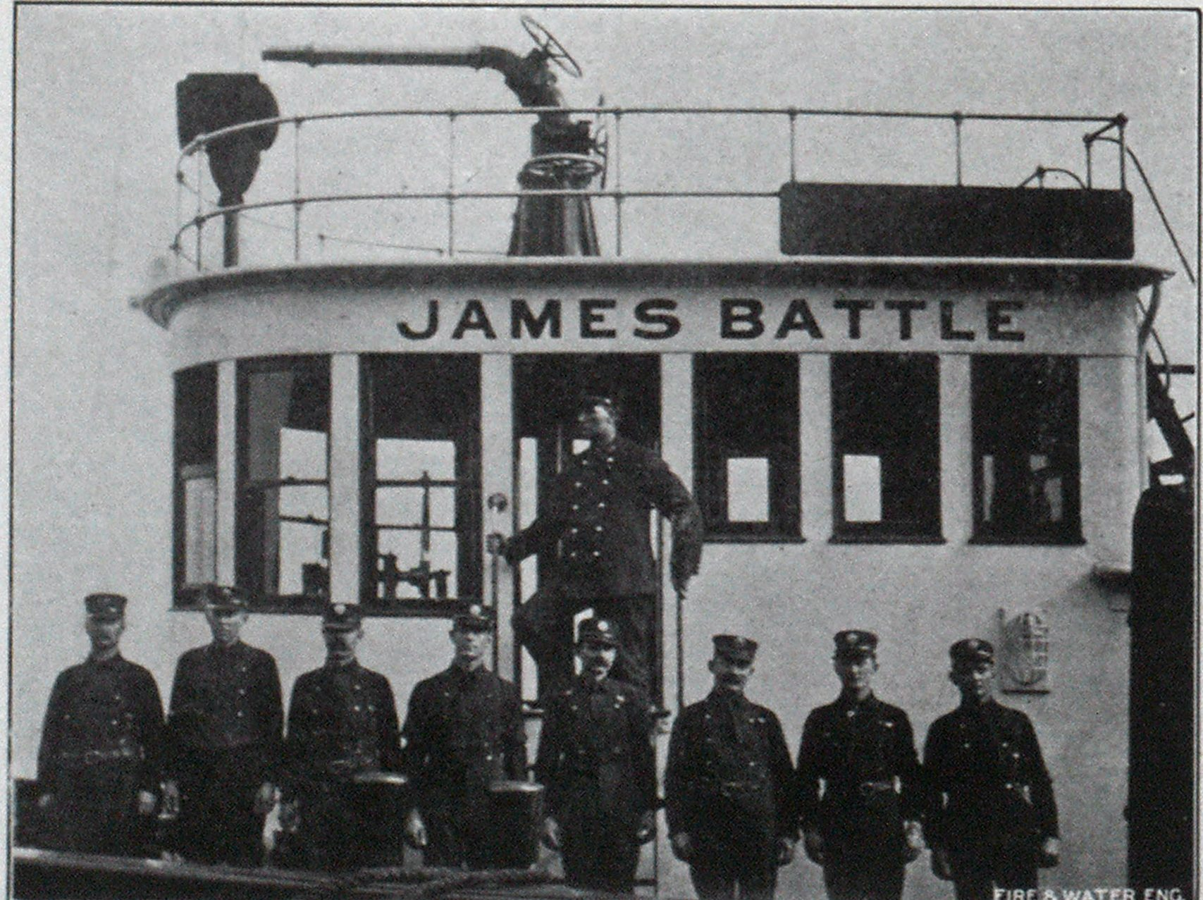 CREW OF THE JAMES BATTLE. From left to right: Capt. Morrison on steps; Lieut. T. J. Noves; G. F. Moore: F. Ponting; M. Keenoy, Cadet; E. Talbot, third officerl; H. L. McGowan; A. Roach and D. H. Carter.