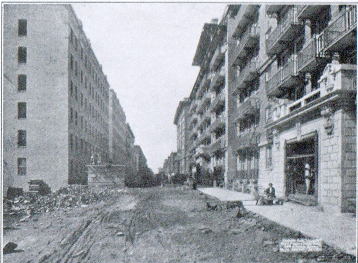 FIG. 1—VANDERBILT TENEMENTS ON RIGHT AND OPEN STAIR BUILDINGS ON LEFT