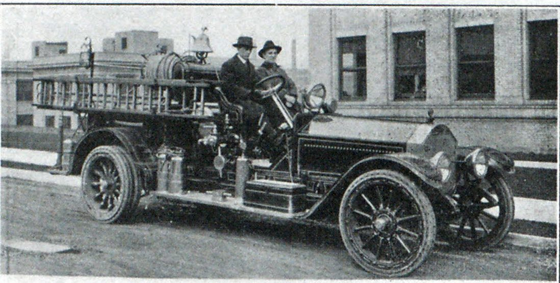 Triple Combination Pumper with Chief Harty on Seat.