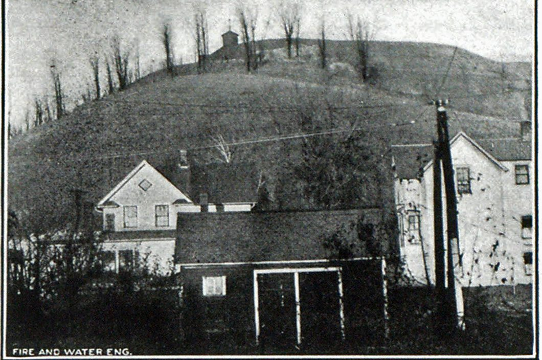 Fig. 3-Pressure Reservoir Built in Sorins Bluff, Across Valley from Barn Bluff, Site of New Well