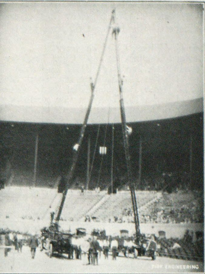 Drill With 85-Foot Aerial. Man in Center, at Top, Preparing to Descend on Life Line