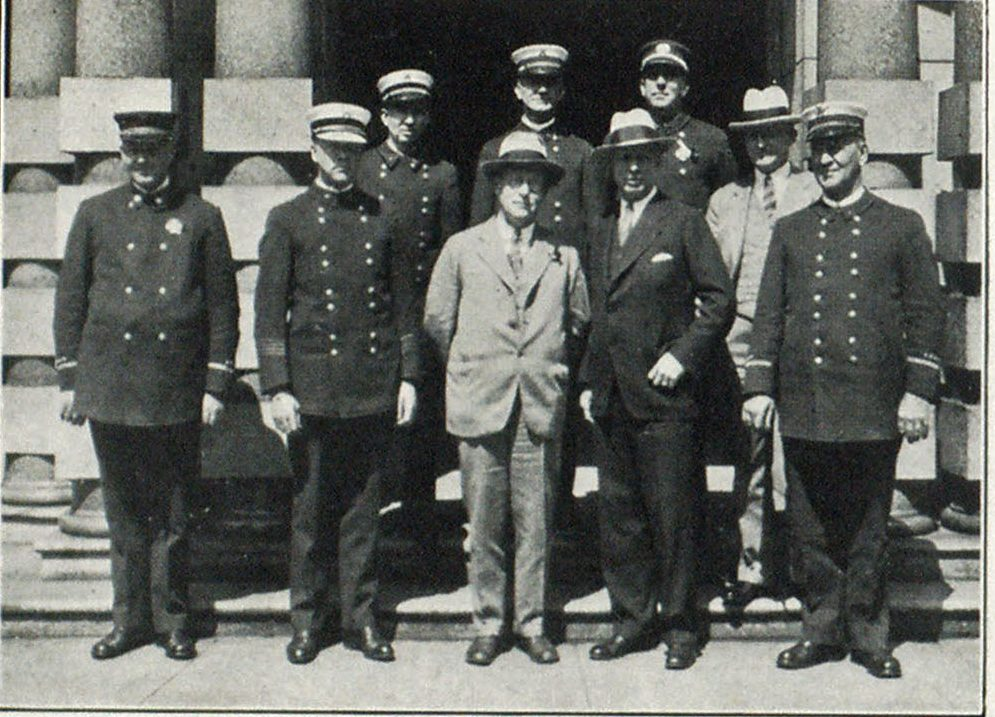 Left to Right: Front Row—Battalion Chief C. O. Haines, Fire Marshal Edw. Grenfell, Commissioner C. A. Bigelow, Finance Committee Chairman Ira F. Powers, and Battalion Chief Wm. D. Heath. Rear Row—Battalion Chief Fred. W. Roberts, Battalion Chief Harry Johnson, and Battalion Chief Willis Smith