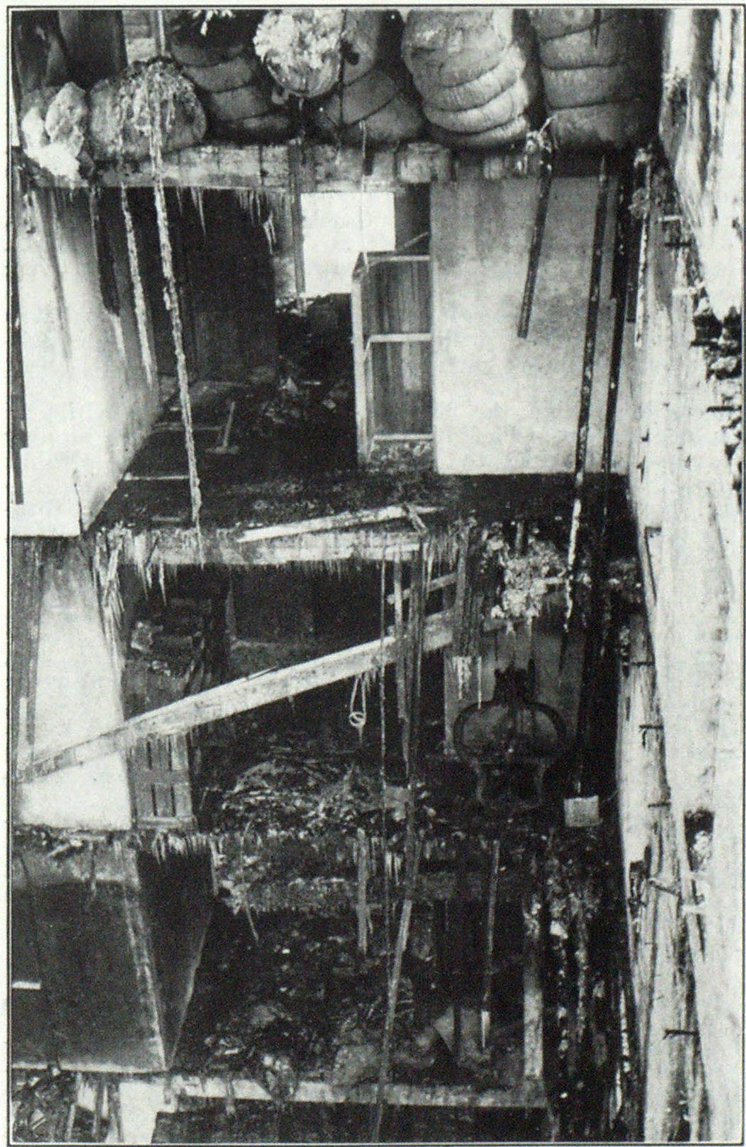 A Typical Case of Floor Failure Note the comparatively small fire damage in the interior of this rag and paper warehouse, although all the floors in the front part of the building were carried through by failure of the upper floors. This occurred in a seven story building in New York City in 1927. Three firemen were killed, ten others were injured. Note the baled rags on the top floor.