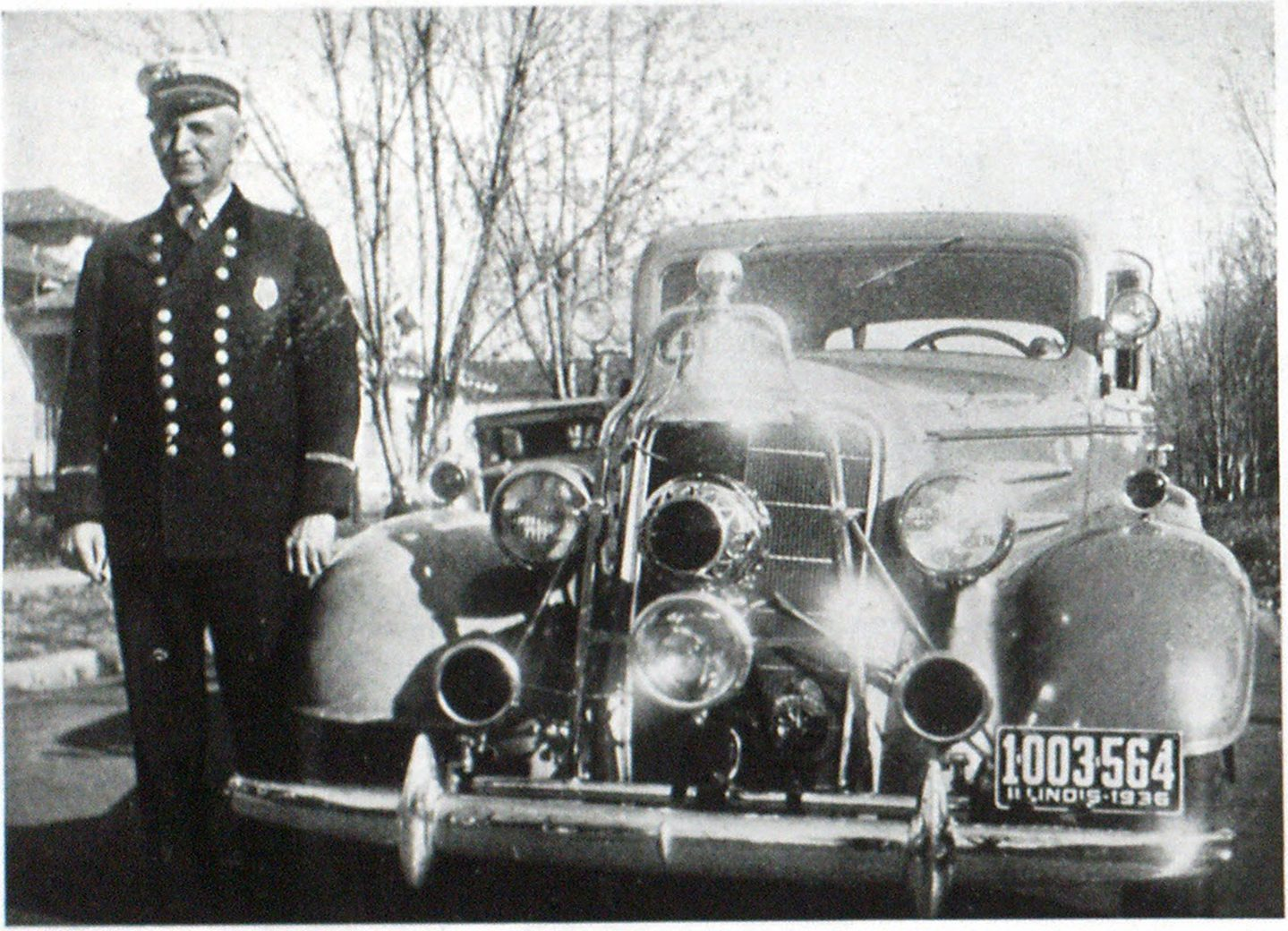 Chief Herring's Car Provided With Fog-Light Chief Albert Herring, Murphysboro, I11., has placed a S & M 50 candlepower fog light on his car and has found it very effective. He writes that they have some very bad fogs in the southern section of his state, and as he often answers calls to points fifty miles from Murphysboro, as a member of the Egyptian Fire Fighters Association, the light has proven of great value. Chief Herring is shown standing beside his car.