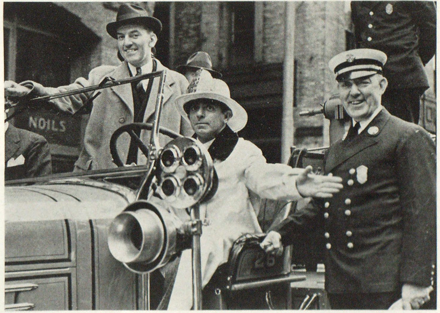 In the Interest of Fire Prevention Fire Commissioner William A. Rielly, Chief Samuel Pope, Boston, Mass., and Eddie Cantor, Motion Picture and Radio Comedian, take part in Boston's Fire Prevention Day Program.