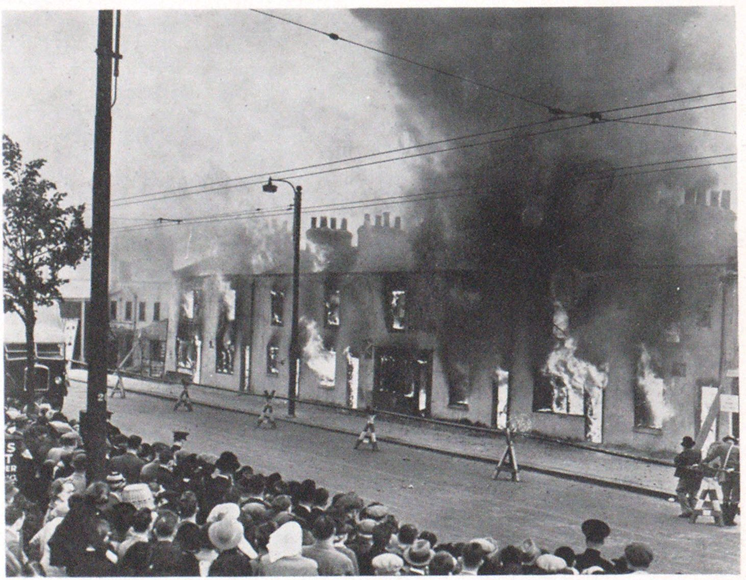 A Demonstration of Air Raid Protection Eight cottages were set on fire in Whetstone High Road. Finchley, London, and twenty dummies were rescued, as part of a realistic air raid precautions exercise. The cottages were set on fire to test the efficiency of the fire-fighting organization.