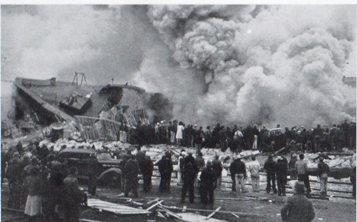 Views of the Fire and Wreckage Resulting from the Gas Blast in Toppenish, Wash. Upper, clouds of smoke from the fire burning underneath the debris.