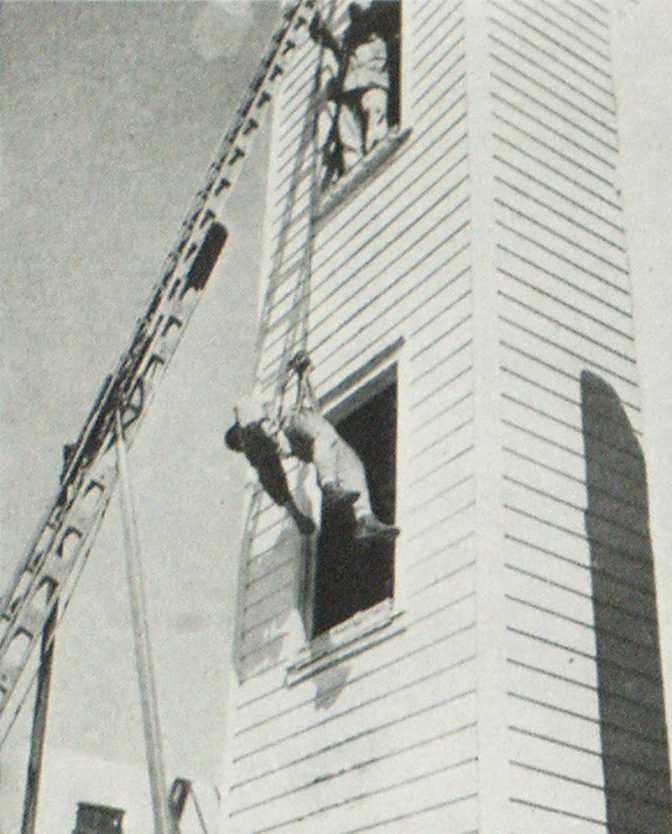 Scenes at the Fire Department Training School Rescue from third floor using a double bowline and forty-foot ladder.