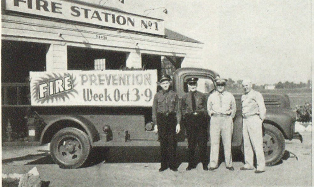 Camp Breckenridge Fire Department Standing in front of the Camp fire truck are W. C. Payne, assistant to the Fire Chief in charge of fire prevention; Fire Chief C. J. Sharp; Major D. C. Artman, the Post Engineer and Post Fire Marshal, and Captain Leland Korb, his assistant.