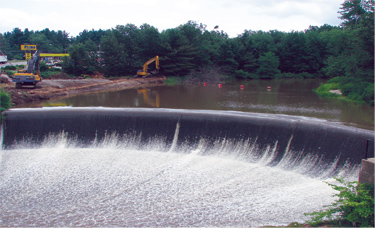 Before its removal, Merrimack Village Dam was a 20-foot-high and 145-foot-wide stone masonry dam overlain with concrete. The dam blocked the migration of diadromous fish and had outlived its usefulness as a water supply structure.
