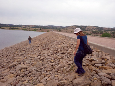 A comprehensive review examination of the upstream face of an embankment dam is completed by Bureau of Reclamation personnel.