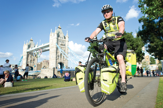 A bicycle responder patrols the Southbank by Tower Bridge.