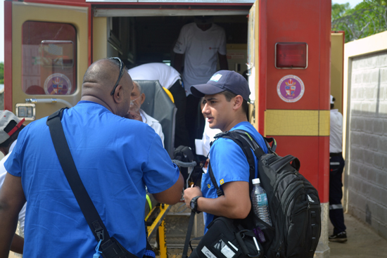 An EMT and paramedic transport their first patient for the Red Cross Dominican Republic.