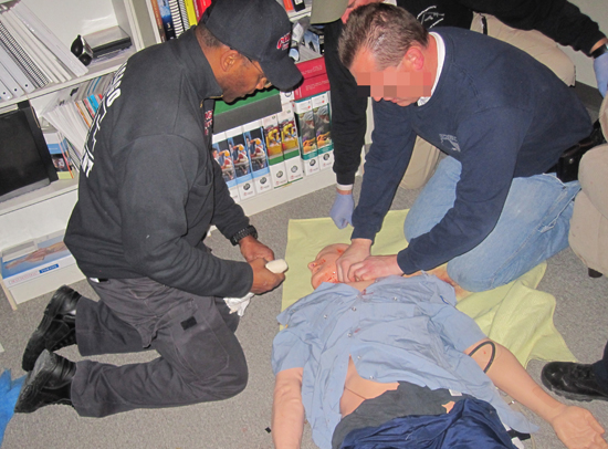 CFD paramedics and CPD officers jointly drill on hemorrhage control during a LEMART simulation session.