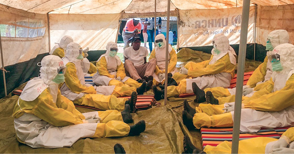 Ogweno training the Ebola rapid response team how to survive the heat while wearing full PPE.