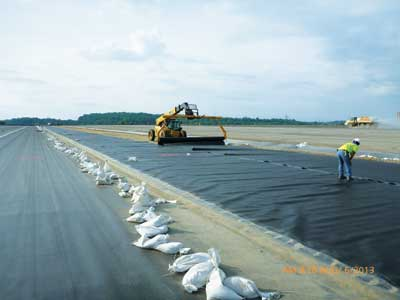 The ash landfill was capped with a geomembrane.