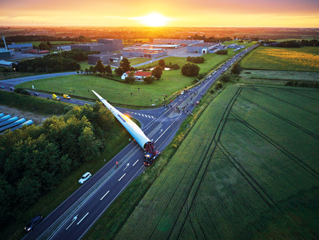 The world's largest turbine blade, manufactured by LM Wind Power, stretches a full 88.4 meters long, allowing for a total diameter of nearly 177 meters. The blade may have been the largest object ever transported on roads in Denmark. Its 218-kilometer trip to a testing facility in Aalborg took just six hours, but it required nine months of planning and coordinating to pull off. Photo courtesy: LM Wind Power